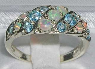 Fifteen VERY COLOURFUL AAA GRADE OPALS & BLUE TOPAZ measuring and