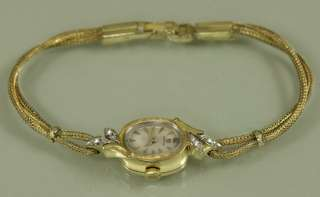14k SOLID GOLD Omega ladies watch, 14k SOLID GOLD CLASP, 4 Genuine