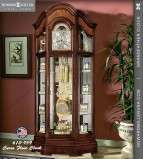 610940 Howard Miller Large curio grandfather Clock in Oak triple chime