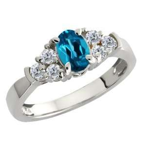 0.79 Ct Oval London Blue Topaz and White Diamond 18k White