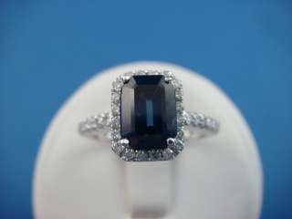 75 CT. SAPPHIRE AND HALO DIAMONDS ENGAGEMENT FRIENDSHIP RING