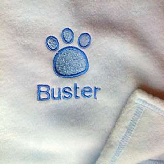 This beautiful personalised fleecy dog blanket with paw print design