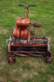 Vintage lawn mower. Royalty Free Stock Photo