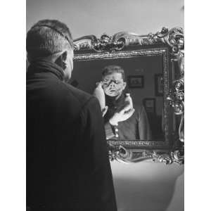 Cartoonist Charles Addams Experimenting with Scary Faces